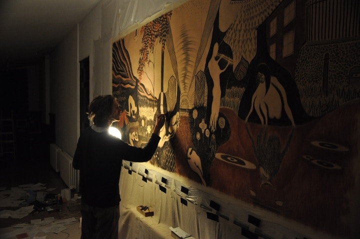 Thomas Allen working on his contemporary cave painting