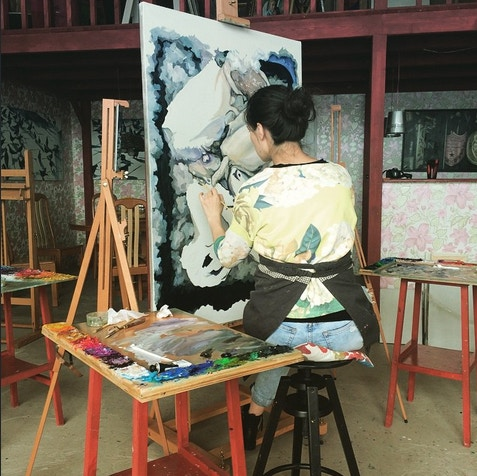 Painter using a Mabef Easel